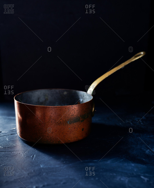 Copper pan in dark setting