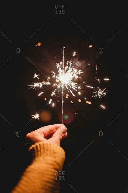 Hand holding a sparkler