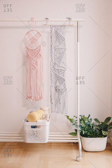 Wall hanging pink macrame decor on a dream catcher.