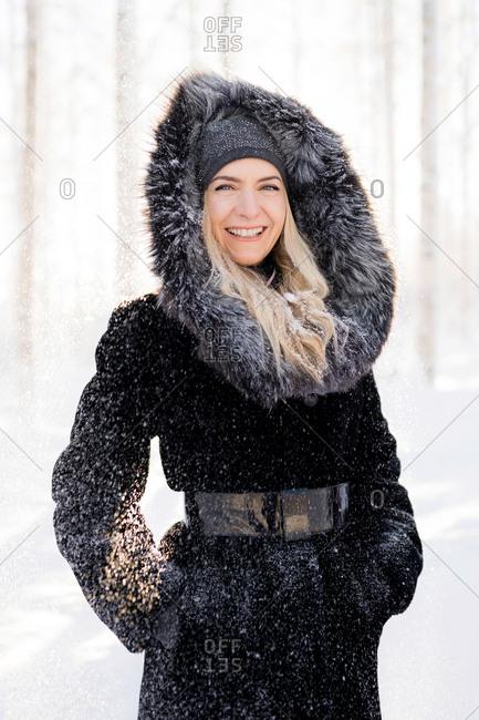 Beautiful woman posing in snowy Finnish landscape