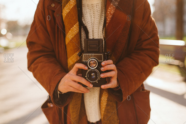 Photographer holding vintage twin-lens reflex camera