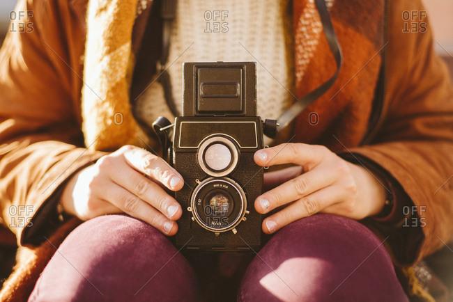 Photographer using vintage twin-lens reflex camera