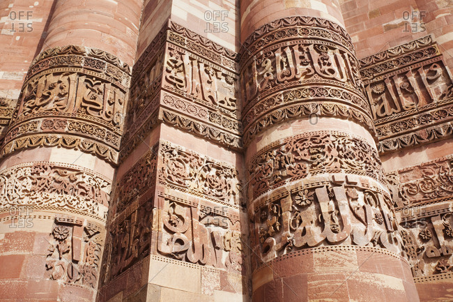 Inscriptions carved into the Qutub Minar Tower,Delhi, Punjab, India