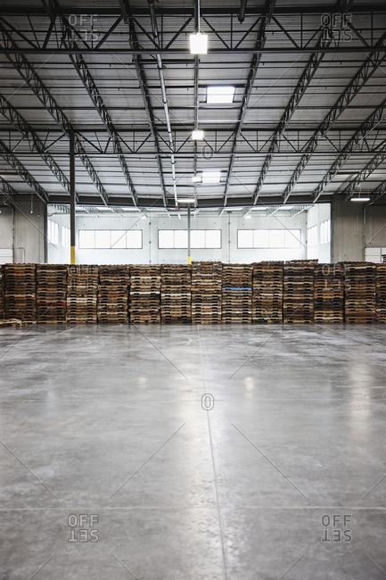 Pallets stacked in warehouse,Sumner, Washington, USA