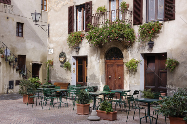 Pienza, Tuscany, ItalyFebruary 8, 2019: Cafe Seating in the Piazza di Spagna