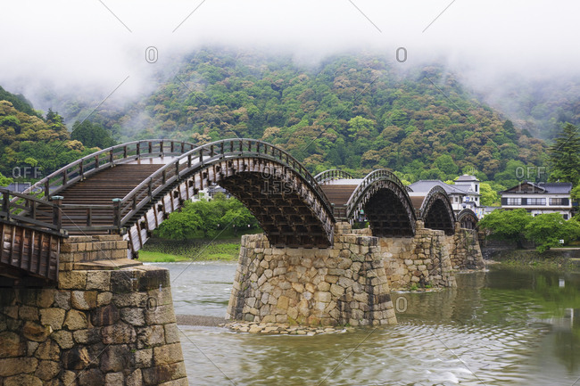 Asian Pedestrian Bridge Over a River