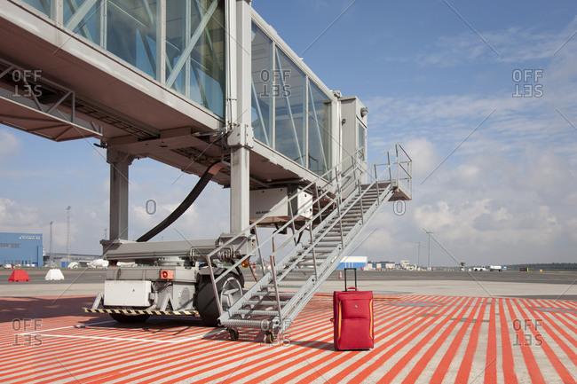 EstoniaFebruary 6, 2019: Suitcase outside airport passenger boarding bridge