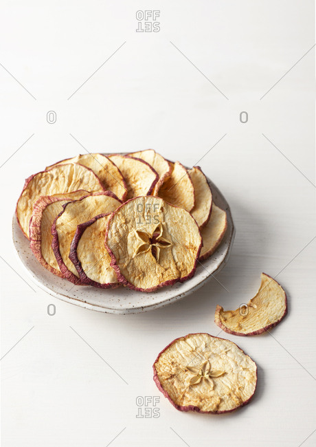 Dried apples on a plate.