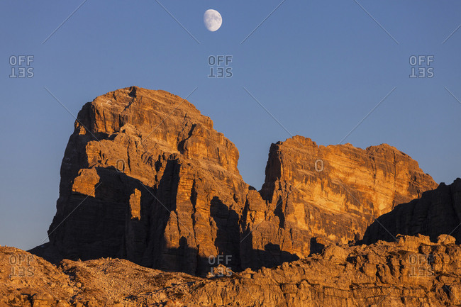 Low angle view of Tre Cime di Lavaredo against clear blue sky during sunset