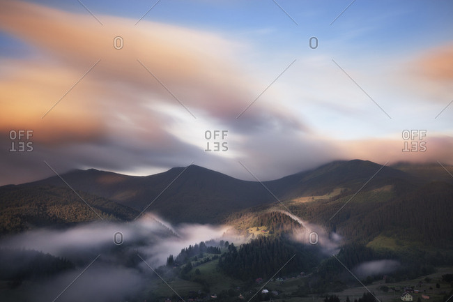 Scenic view of Carpathian Mountains against cloudy sky during sunrise
