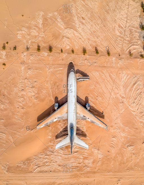 May 11, 2018: Aerial view above of museum airplane on desert landscape, Abu Dhabi, U.A.E