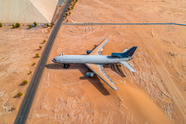 May 11, 2018: Aerial view of museum airplane on desert landscape, Abu Dhabi, U.A.E