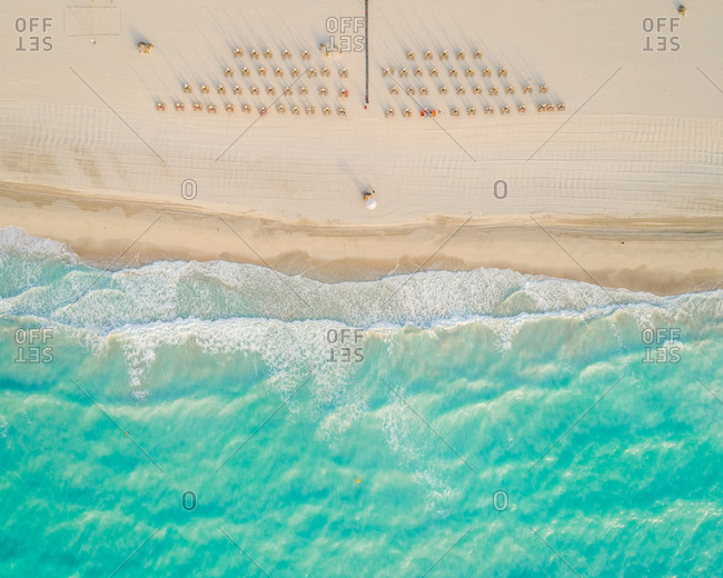 Aerial view of umbrellas and sun chair at beach, Abu Dhabi, U.A.E.