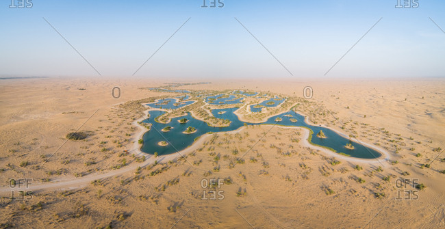 Aerial view of big oasis in the middle of desert landscape, U.A.E.