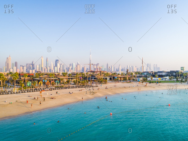 September 26, 2018: Aerial view of a luxury beach with Dubai skyscrapers at the background, U.A.E.