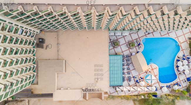 Aerial view of balconies facing swimming pool, Dubai, U.A.E.