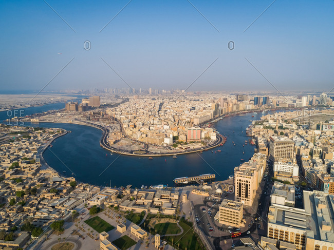 October 7, 2018: Aerial view of navigable river crossing suburbs, Dubai, U.A.E.