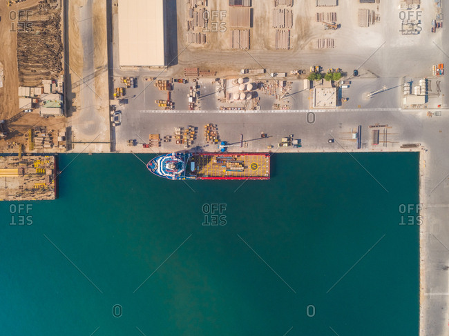 October 5, 2018: Aerial view of a boat being loaded at sea port, Dubai, U.A.E.
