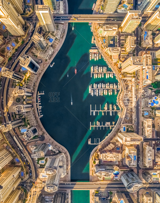 October 8, 2018: Aerial view of Dubai Marina with moored boats and skyscrapers, UAE.