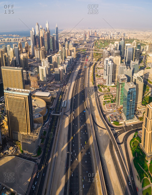 October 8, 2018: Aerial view of multi-lanes highway crossing the city, Dubai, U.A.E