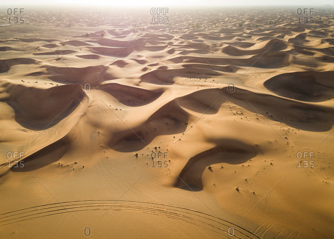 Aerial view of dunes creating shadows at a desertic landscape, U.A.E.