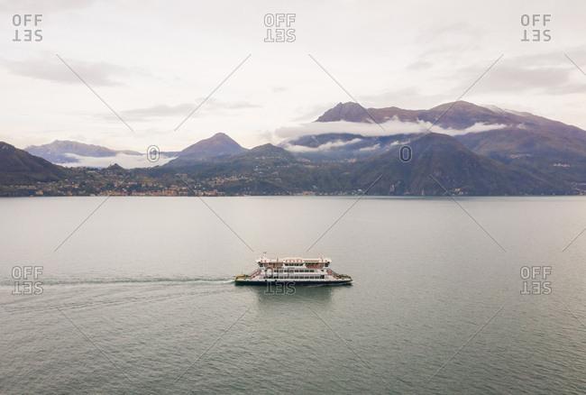Aerial view of single ferry boat crossing Lago di Como, Cadenabbia, Italy.