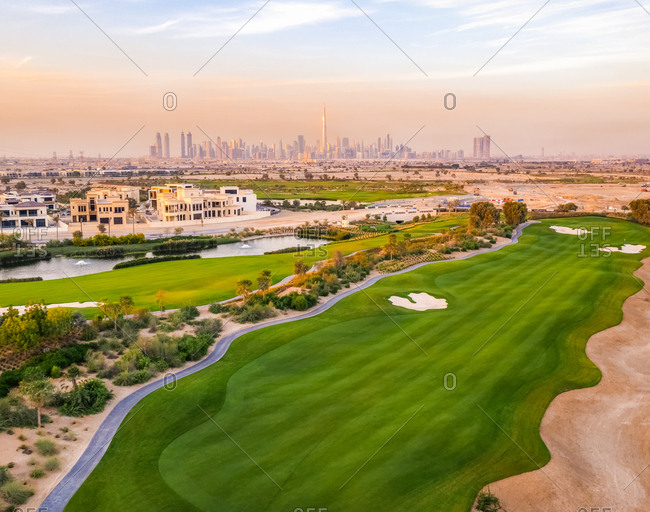 November 14, 2018: Aerial view of luxury golf club with Dubai at the background, U.A.E.