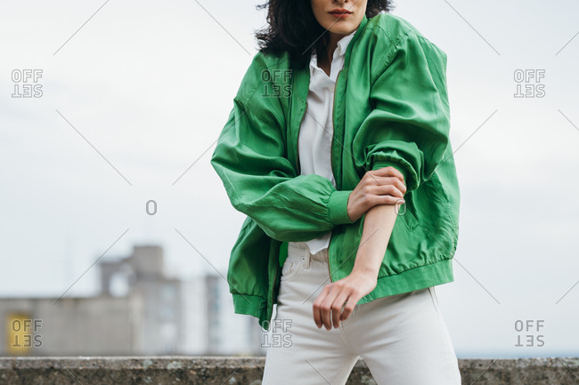 Unrecognisable woman fashion model rolling up her sleeve.