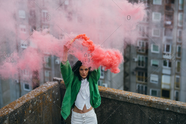 Beautiful attractive woman model posing with pink smoke boom.