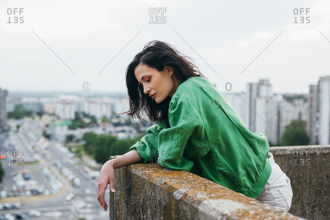Beautiful urban woman fashion model posing on a rooftop.