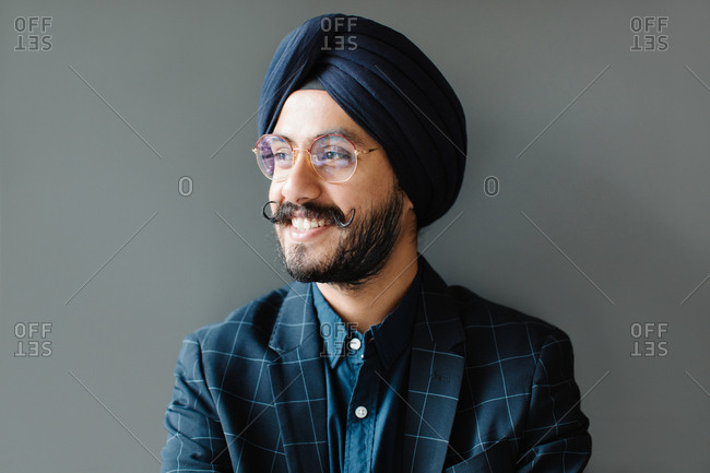 Portrait of handsome smiling Indian sikh man wearing turban.