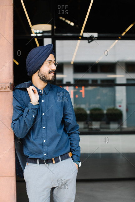 Portrait of handsome Indian sikh businessman wearing turban.