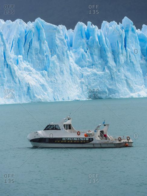 Argentina- Patagonia- El Calafate- Glacier Perito Moreno with excursion boat in the foreground