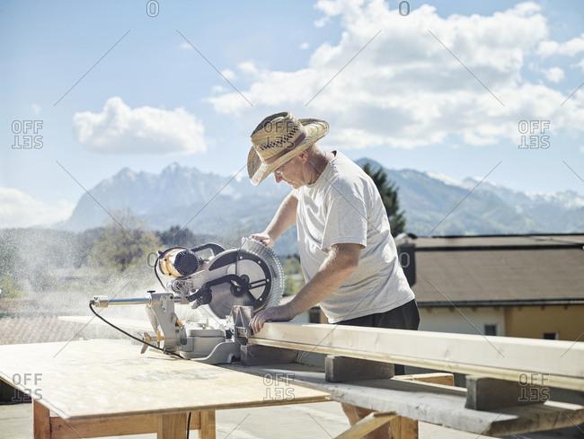 Carpenter working- circular saw