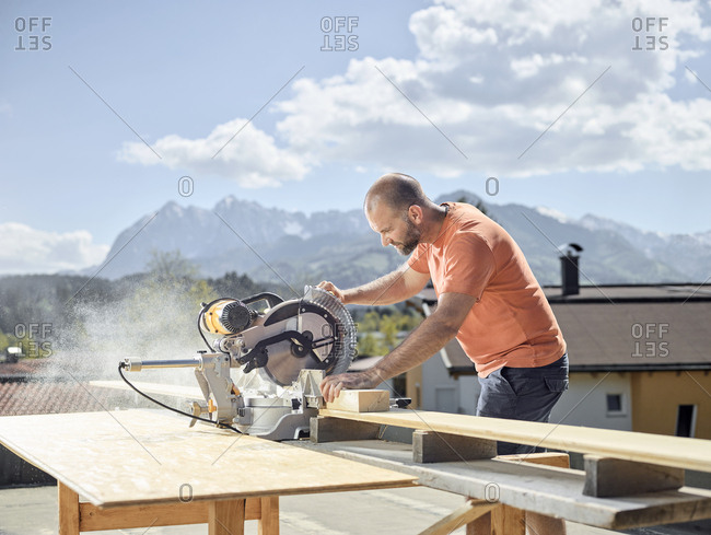 Carpenter working- circular saw