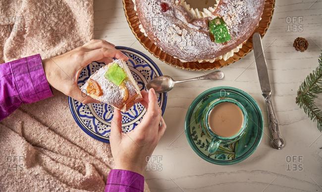 Hand serving piece of Spanish Christmas cake