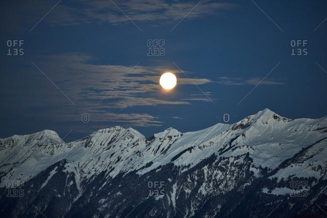 Switzerland- Bern- Hasliberg- moon over snowcapped mountains