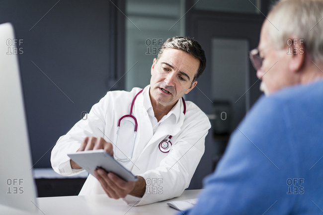 Doctor showing tablet to patient in medical practice
