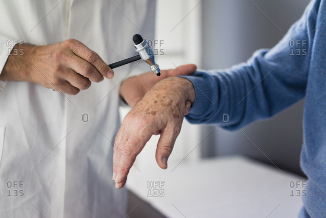 Close-up of doctor examining senior patient in medical practice