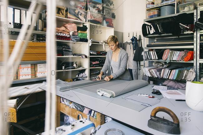 Fashion designer working on template in studio