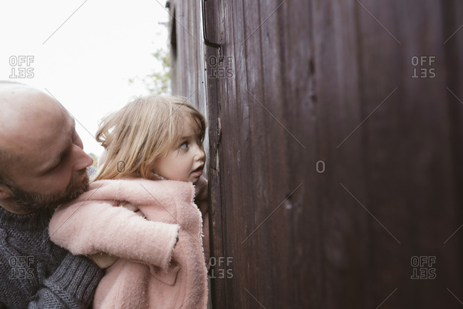 Curious little girl with father