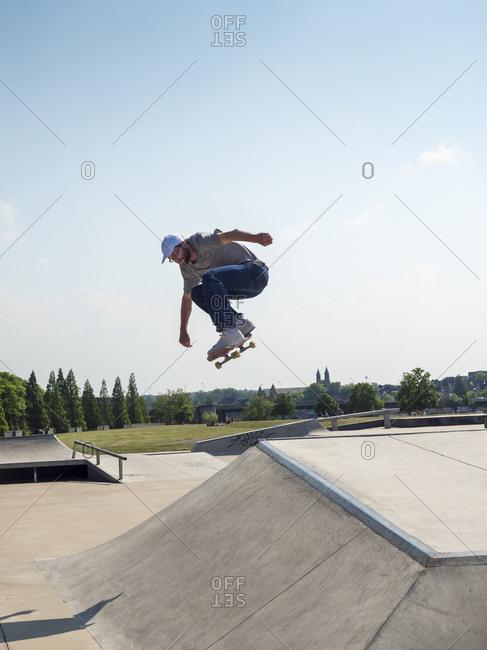 Young man skating in skate park
