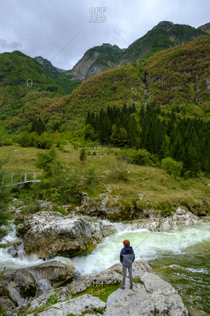 Slovenia- Soca Valley- hiker at Lepenjica river- Triglav National Park