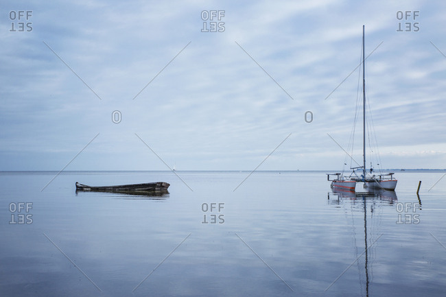 Germany- Ruegen- Putbus- Lauterbach- catamaran and boat wreck on the Baltic Sea