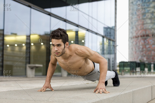 Young man during workout- pushup