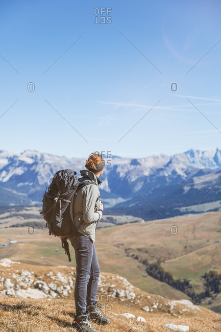 Italy- South Tyrol- Dolomites- Hafling- female hiker with backpack looking at distance