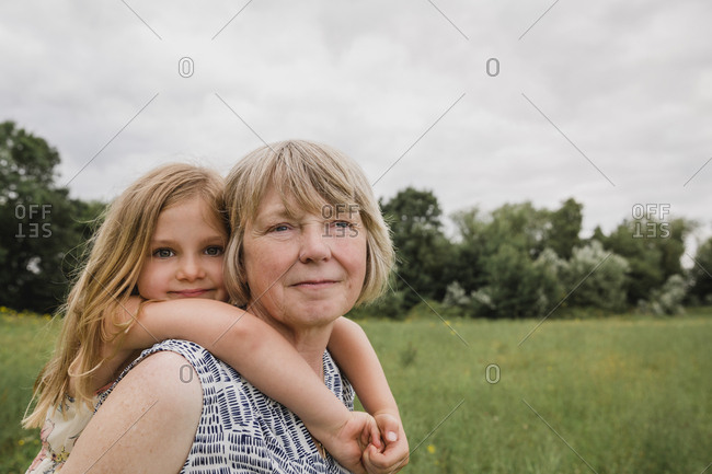 Grandmother giving granddaughter a piggyback ride