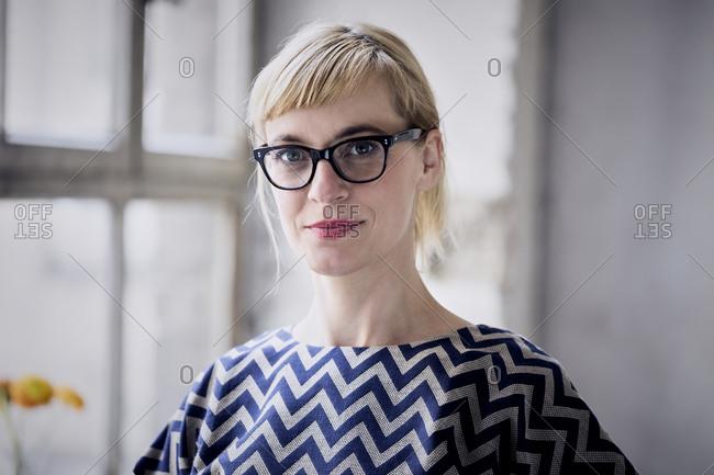 Portrait of blond businesswoman wearing glasses