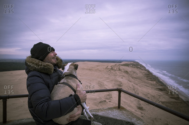 Denmark- North Jutland- Rubjerg Knude Lighthouse- laughing man and his dog at blue hour