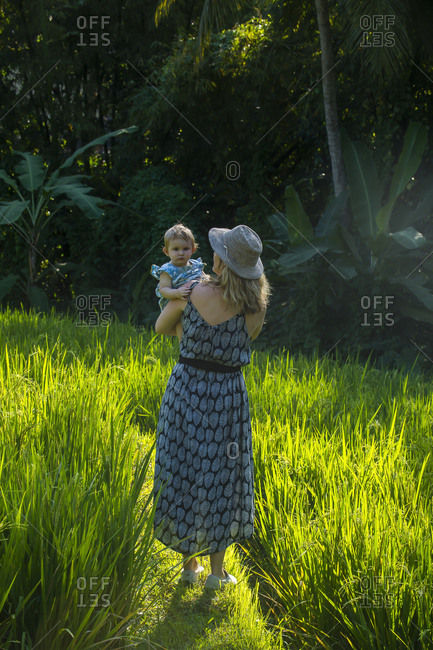 Indonesia- Bali- Ubud- Woman with her baby girl in the rice paddies
